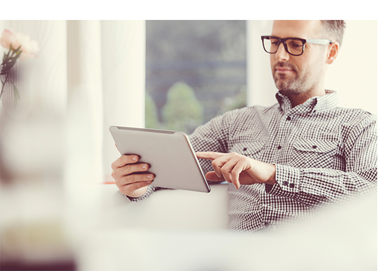 Man with tablet surfing in a webshop